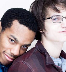 A happy and attractive interracial gay couple.